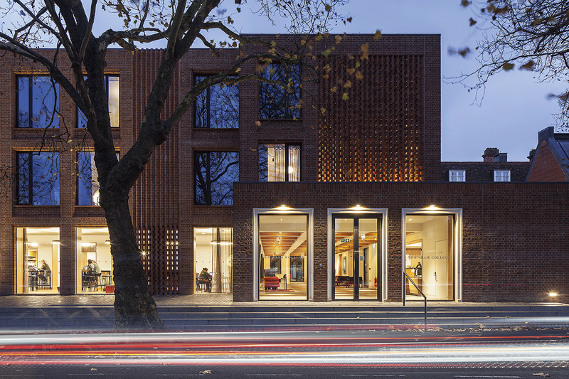 The Sidgwick Avenue elevation of the Dorothy Garrod Building with its illuminated hit and miss brickwork creating an understated, elegant entrance.