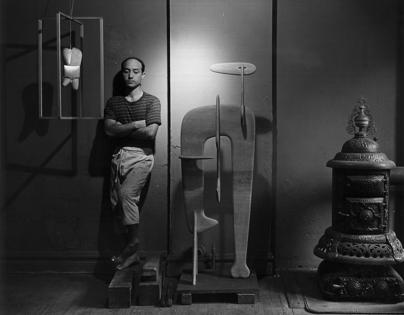 Portrait of Isamu Noguchi, 4 July 1947. Photograph by Arnold Newman.  ©Arnold Newman Collection / Getty Images / INFGM / ARS – DACS. From Noguchi, until 9 January 2022 at the Barbican Art Gallery