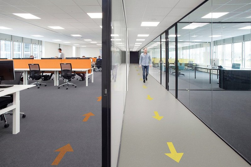 Walk this way: Forbo's Tessera Layout carpet tiles (left) and Marmoleum sheet flooring (right) can both be specified with directional arrows.