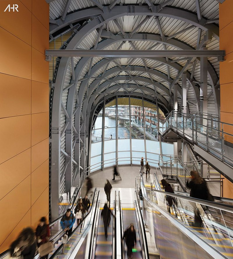 Passengers have views of the exposed diagrid steel structure as well as the River Aire as they travel on the escalators.