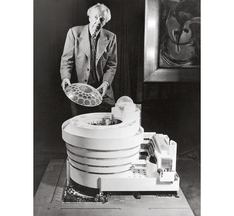 Frank Lloyd Wright with the large-scale model of his design for the Solomon R Guggenheim Museum.