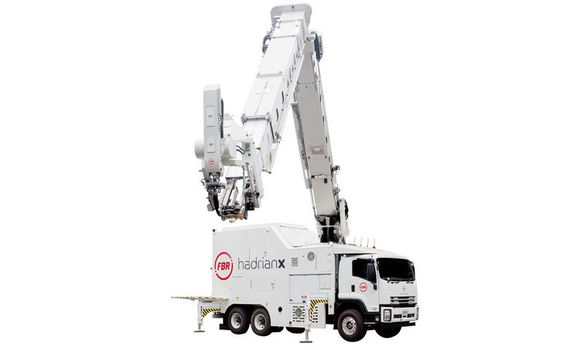 FBR's Hadrian‑X robot is mounted on a truck that manoeuvres around a site to build a home.