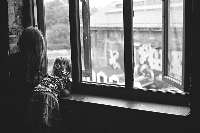Children leaning out of window.