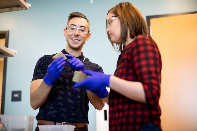 Wil Srubar, an assistant professor in the Department of Civil, Environmental and Architectural Engineering and CU Boulder graduate student Sarah Williams in the lab