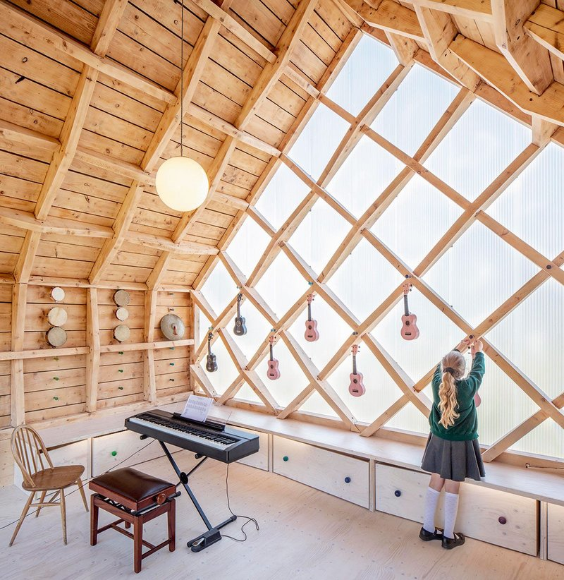 Interior of St. John's School Music Pavilion, designed by Clementine Blakemore Architects at Lacey Green, Buckinghamshire. Completed in 2019, the second phase of the project enclosed what was previously an outdoor classroom.