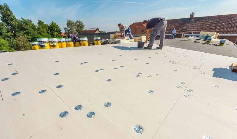 Tapered insulation schemes keep flat roofs dry and the buildings beneath them warm.