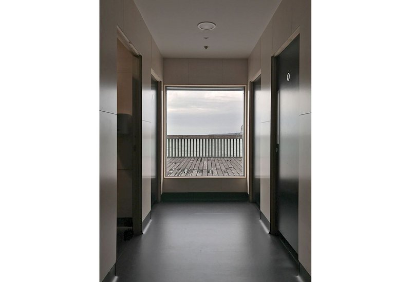 Seven gender-free toilet spaces are indulged with wide access windows and large picture windows to the sea beyond.