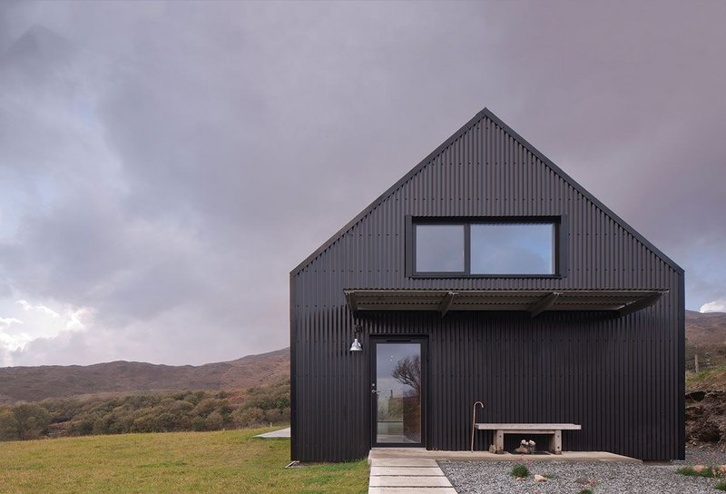 The house is reduced to three basic materials – aluminium sheeting, timber and resin.