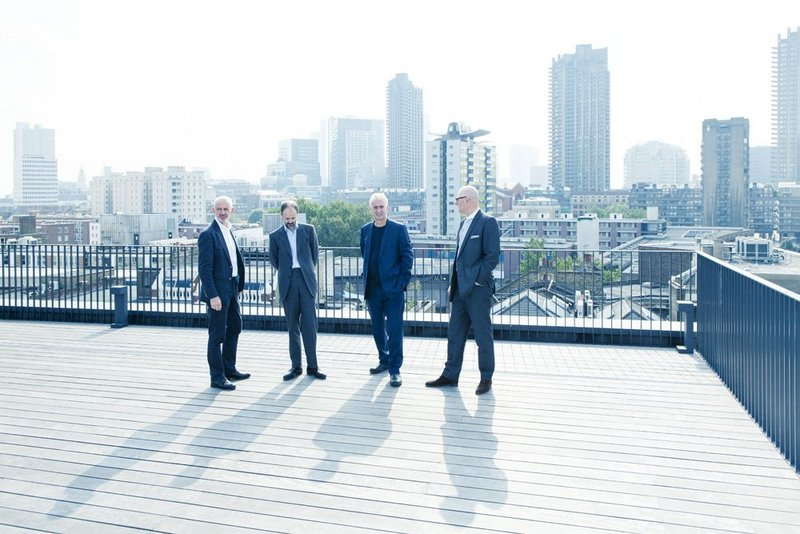 Our city: from on top of the office Peter Morris, Jonathan Hall, Paul Monaghan and Simon Allford.
