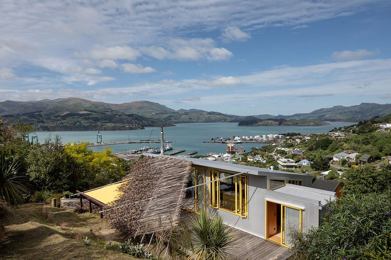 The plywood pavilion opens to both sky and harbour.