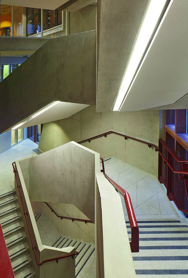 The luxury of austerity: the main stair is terrazzo and concrete, with painted steel and warm timber.