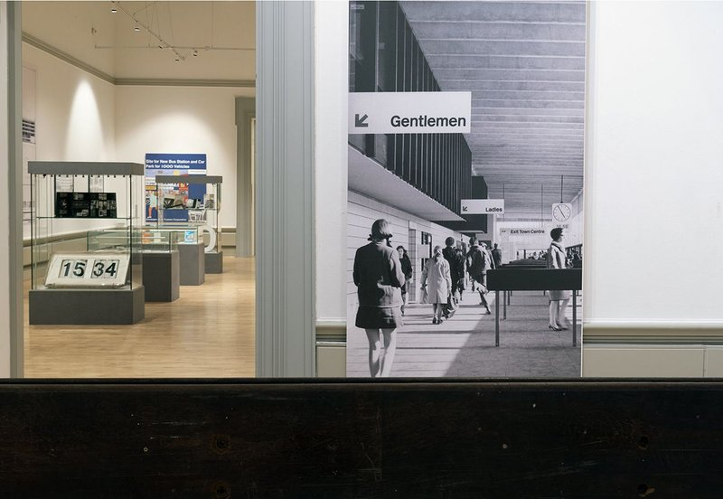 Installation of the Beautiful and Brutal– 50 Years in the life of Preston Bus Station exhibition. An archive interior image is on the right.