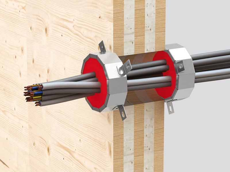 Cable penetrations through CLT are firestopped with Hilti's tested and approved CF CC cable collar, a dry fit solution.