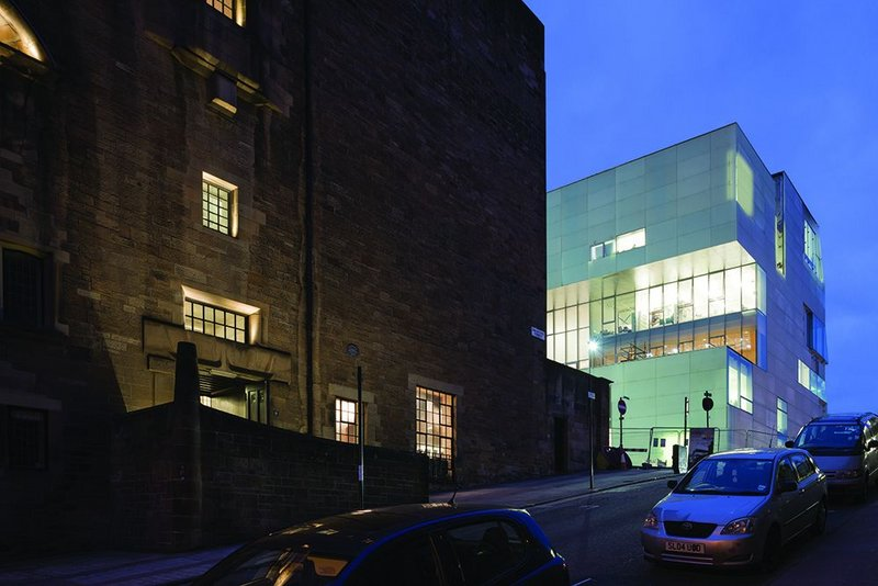 The bright facade of the Reid Building may look like an interloper by day but at night it glows, a lantern perched uphill of Mackintosh's Glasgow School of Art.