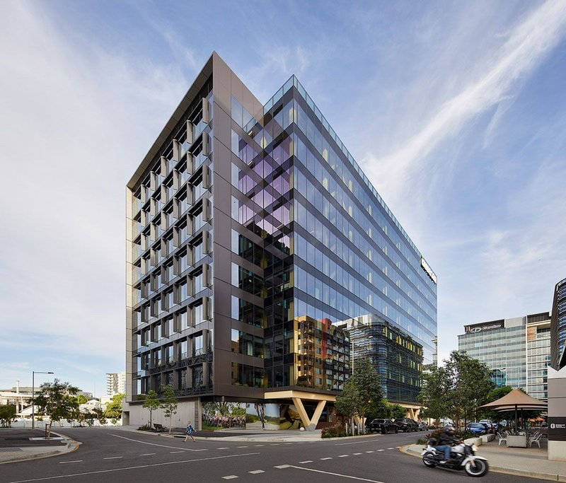 Bates Smart's 25 King, Brisbane, Australia, is hybrid in form - a timber tower with a ground floor concrete frame.
