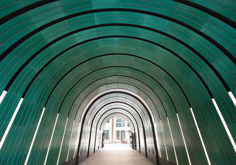 Jade green rainscreen panels wrap across the arch for the entire length of the Rathbone and Newman Passages in a rhythmic design enveloping those passing through the tunnels.