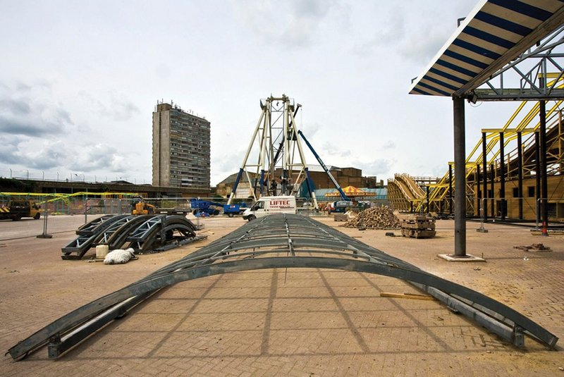 Beyond the site of the big wheel, Margate's brutalist housing tower looks down over Dreamland.