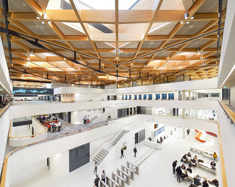 People collaborating around the National Automotive Innovation Centre in Coventry, designed by Cullinan Studio.