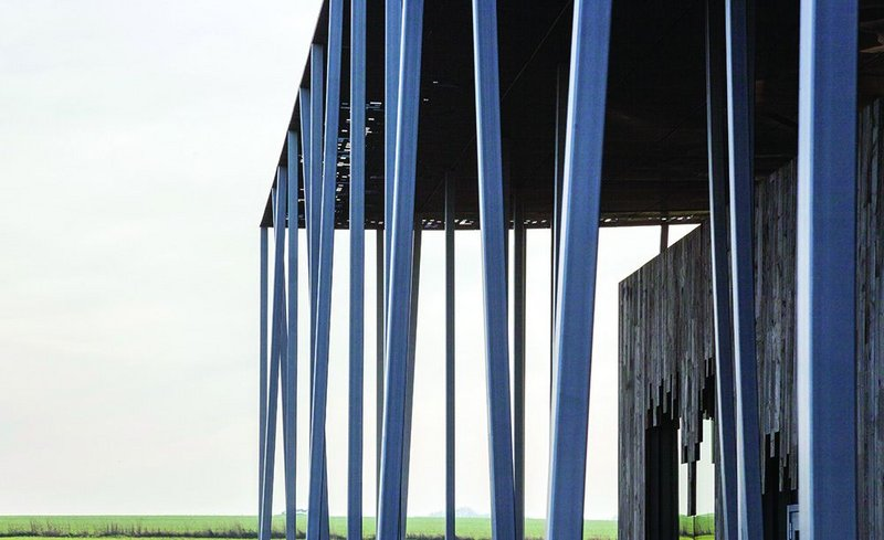 Super-slender columns emulate copses on Salisbury Plain at Stonehenge Visitor Centre