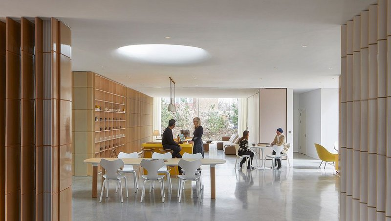 An oculus above the central dining table is at the heart of the open-plan interior.