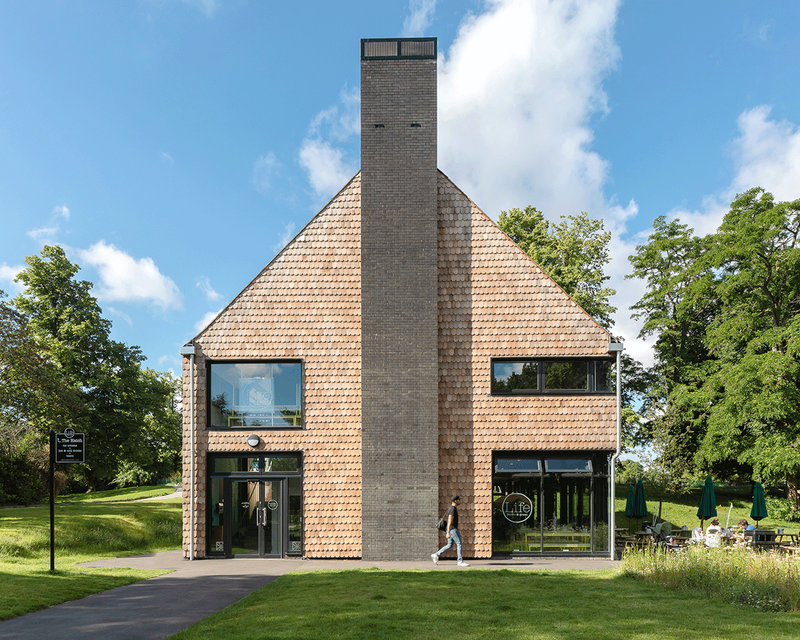 The prominent brick chimney ensures that the new cafe building is easy to locate in the park.