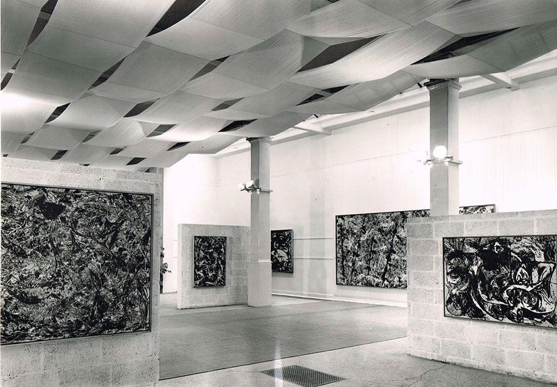 Installation view of Jackson Pollock exhibition 1958, designed by Trevor Dannatt at the Whitechapel Gallery. © Whitechapel Gallery. The installation featured an assemblage of breezeblock walls, fabric canopy and carpet to create a space within a space.