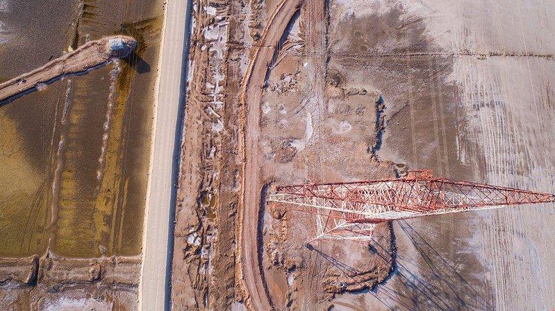 Aerial image of Al Ruwais Sabkha in the UAE, the flat salt-encrusted desert that inspired the pavilion.