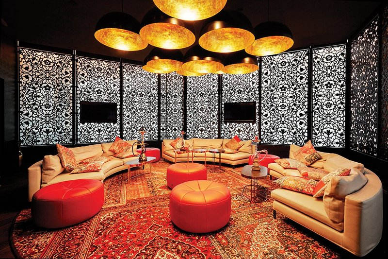Shisha lounge where the carpet is printed with the effect of overlaid Persian rugs.
