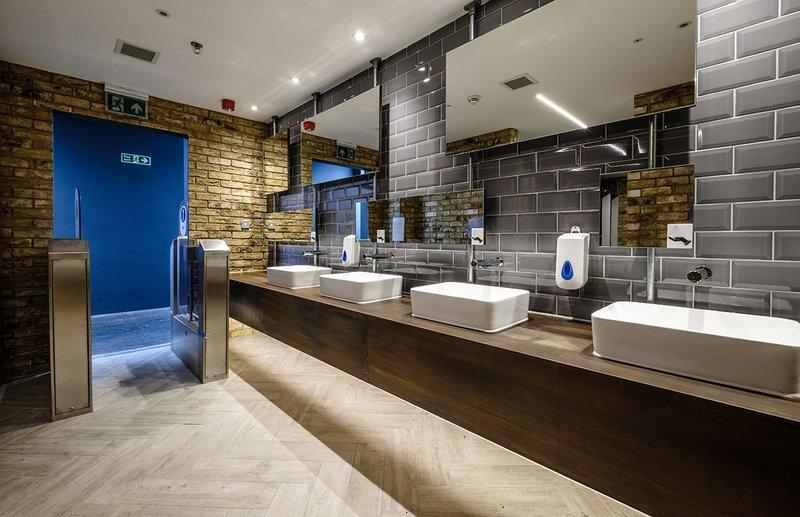 Washroom Washroom's rusted effect mild steel laminate vanity units, metro tiles and exposed brick bring industrial style to Camden Market.