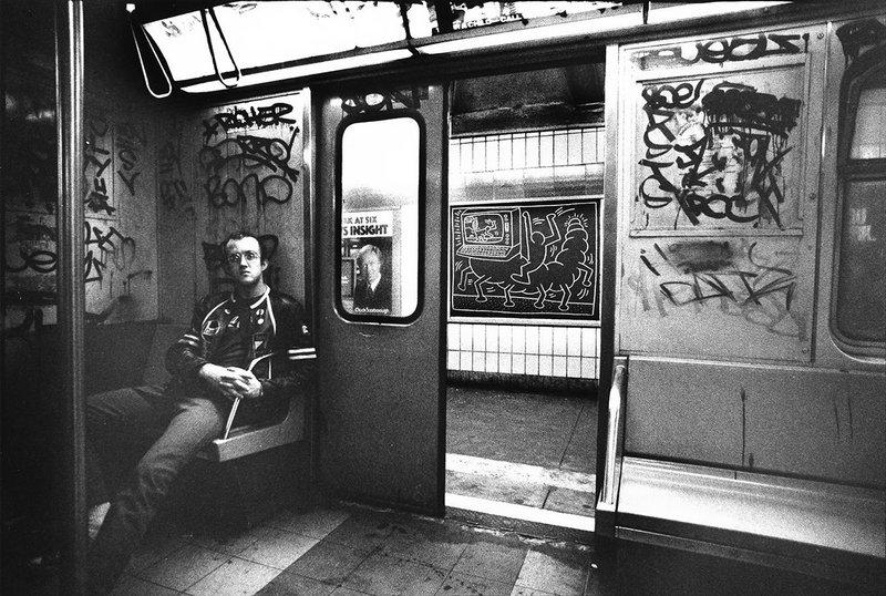 Keith Haring in subway car, (New York), circa 1983.  Tseng Kwong Chi photo © Muna Tseng Dance Projects, Inc. Art © Keith Haring Foundation