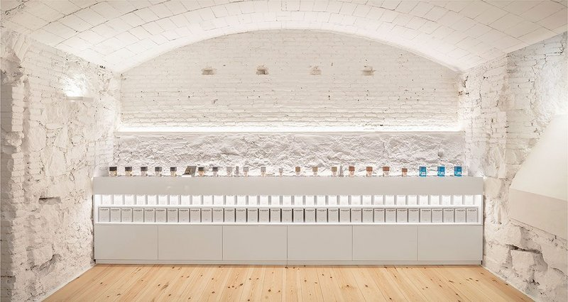 Against the white walls and white joinery, the perfume bottles make their presence delicately felt.