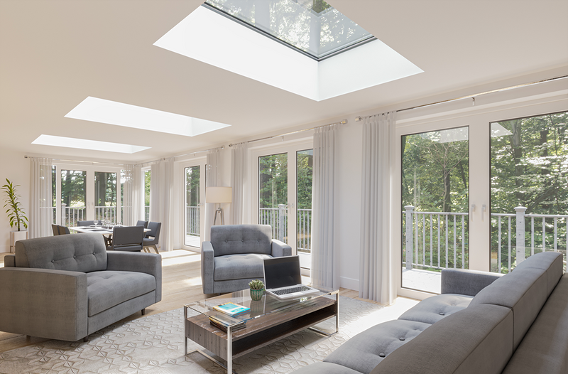 Neo Advance flat rooflights and a run of floor-to-ceiling glazed doors bring landscape and sky views to a seating and dining space.