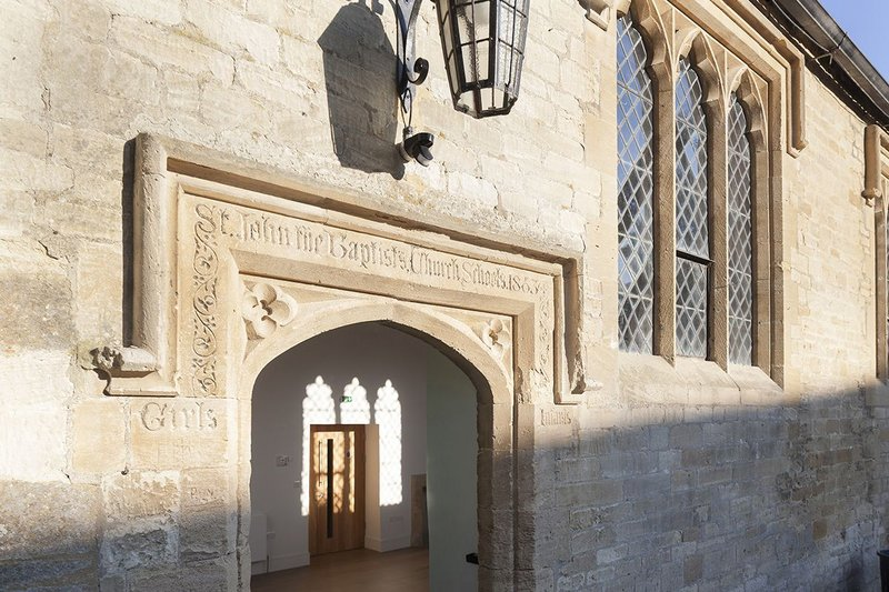 The old entrance to Warwick Hall with inscriptions from when it was used as a schoolroom.