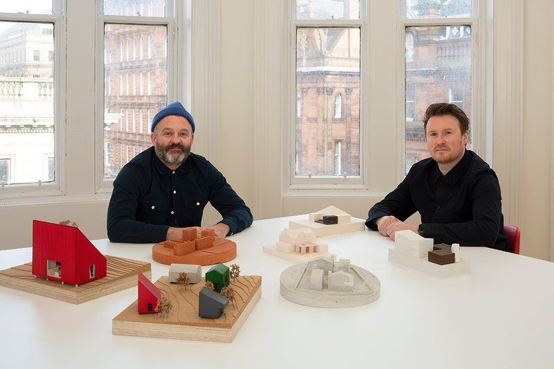 Surrounded by their working models, Mark Bell and Brian McGinlay in their new Baltic Chambers office in the heart of Glasgow.