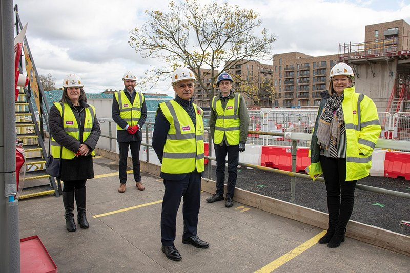 London mayor Sadiq Khan visits a housing scheme in Barking. The new London Plan aims to boost affordable housing for Londoners.