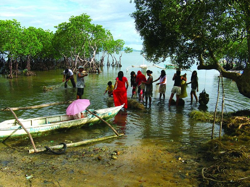 Locals collecting the discarded nets and post consumer waste marring their shoreline, and generating revenue as they do so.