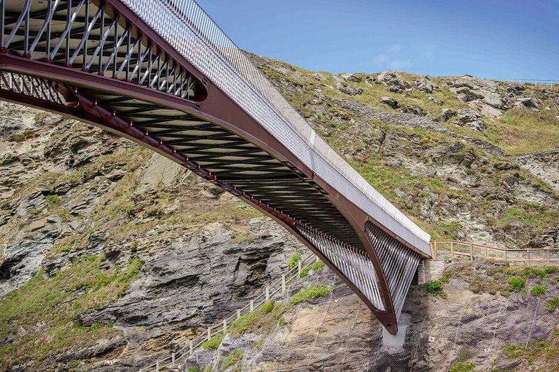 Each of the bridge's two sections spans 30m, springing off concrete footings on the cliffside.
