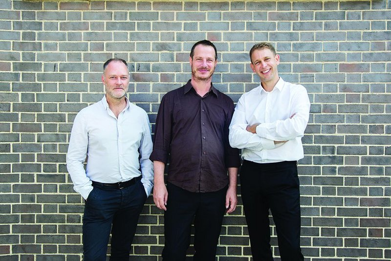 From left: Christopher Watson, William Mann and Stephen Witherford outside their Amnesty International base in East London.