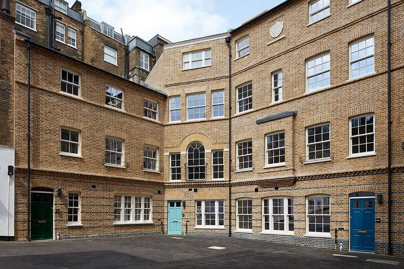 Lomax + Wood timber sash windows, entrance doors and fire windows at new-build Deans Mews, Marylebone, London.