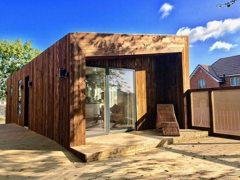 The timber-clad TAM could be parked in the back gardens of Knowle West.