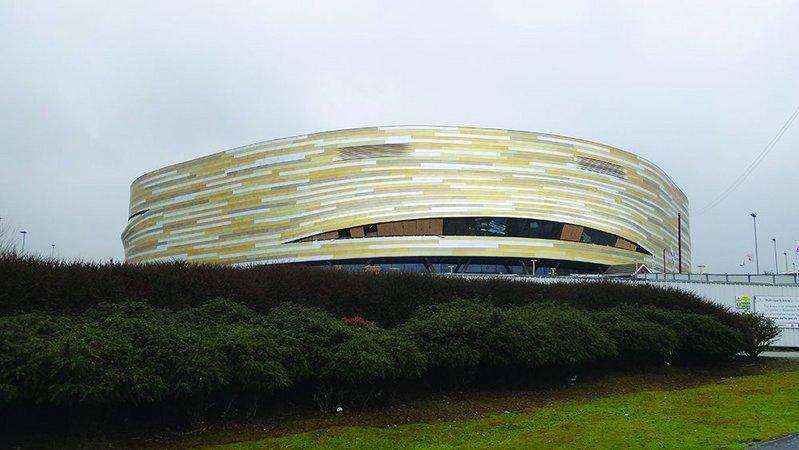 Aluminium shingles cover the exterior of the arena.