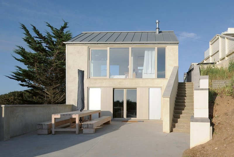 The house reuses what was there but roof, render, openings and terrace are updated.