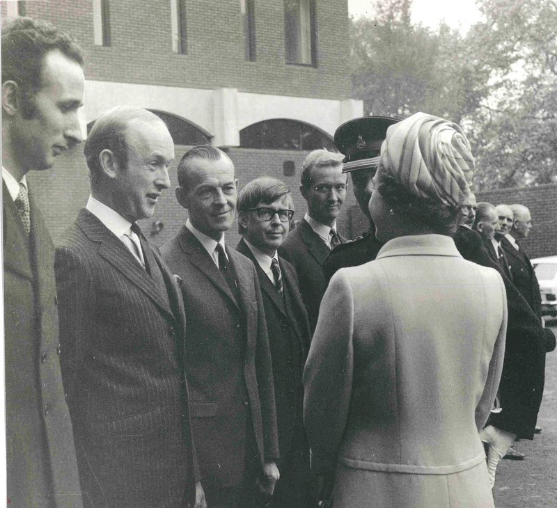Dangerfield - second from left - with the Queen at the opening of Knightsbridge Barracks. Credit Dangerfield family