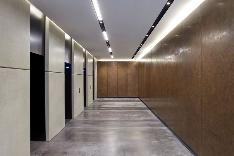 Bennetts Associates has specified Lazenby Mayfair Grey concrete floor with a brass trim for One Bedford Avenue in London.