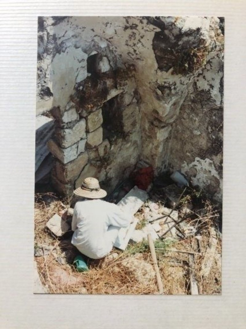Photo of a fellow student undertaking a survey of an archaeological site in Israel, 1992.