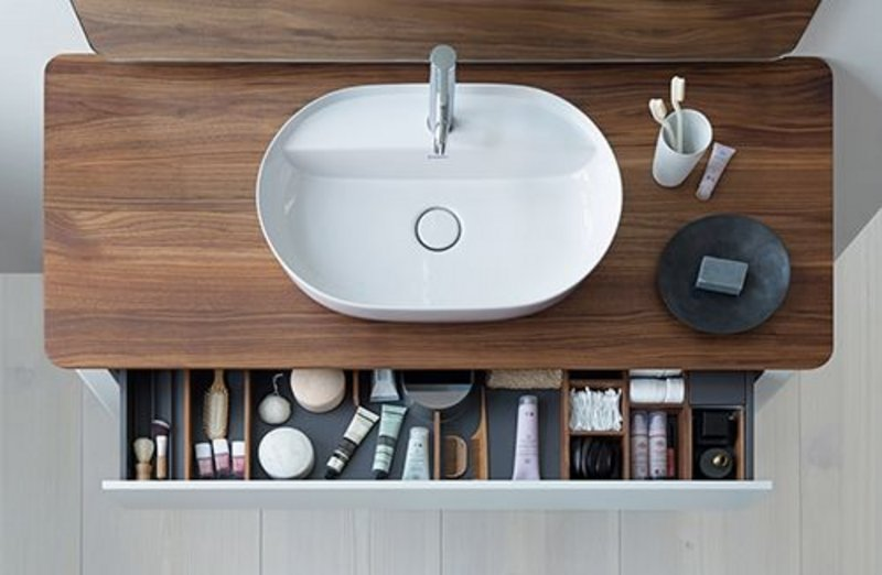 The handle-free drawers of Duravit's Luv freestanding bathroom unit by Danish designer Cecilie Manz provide plenty of storage space: they open via tip-on technology and close with self-closing action.