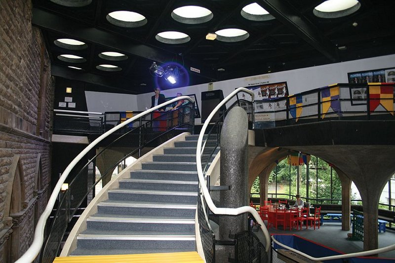 Before image showing the sweeping 1960s stair up to the second floor as well as how the theatre lost its original aesthetic intentions over time.