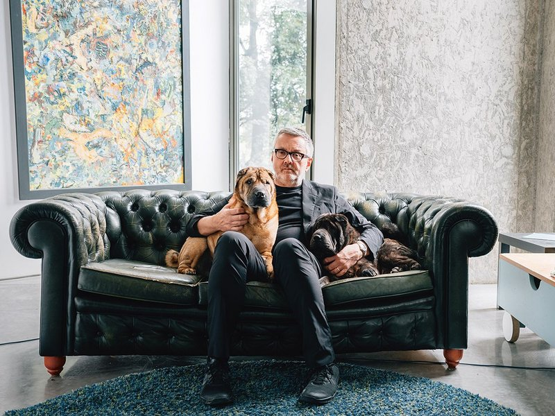At home with his architecture and his dogs.