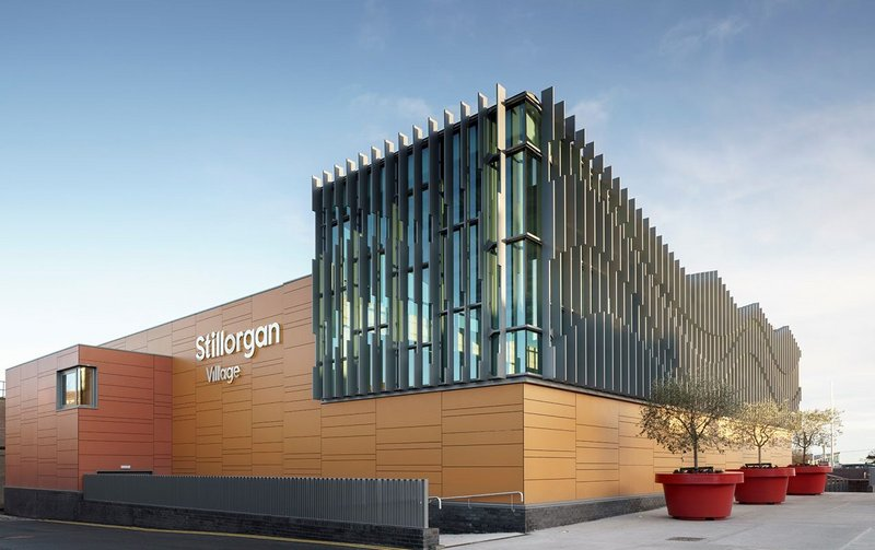 Swisspearl Carat fibre cement cladding in Topaz, Onyx and Coral at Stillorgan Village Shopping Centre in Dublin.