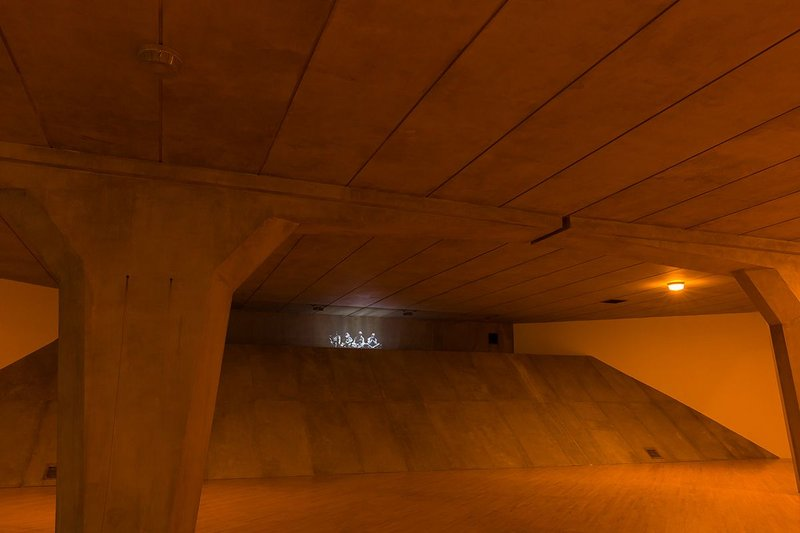 A shaft of light penetrates the underpass from above.